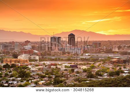 Tucson, Arizona, USA downtown city skyline with mountains at twilight.