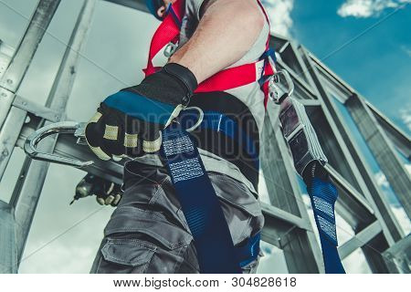 Safety Harness Equipment Closeup. Caucasian Contractor In His 30s On A Steel Building Frame. Working