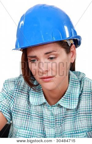Sad female builder