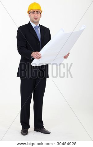 Bemused architect with plans