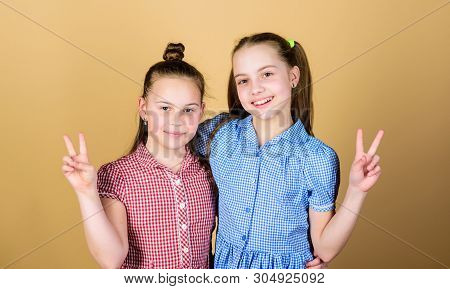 Peace Begins With You. Cute Small Children Gesturing V Signs For Peace. Adorable Little Girls Showin