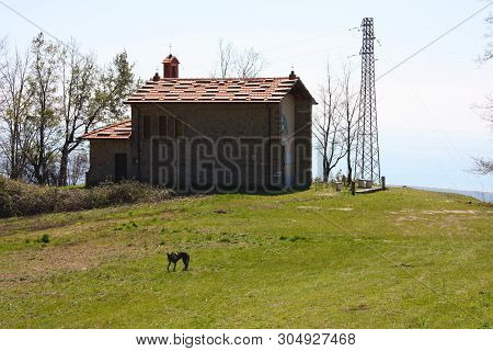 Small Church Abandoned, In Disuse, On The Apuan Alps Of The Tuscan Apennines In A Clearing On A Sunn