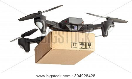 Drone With A Cardboard Box Makes Delivery By Air. Drone With A Camera Carries Postal Parcel. Isolate