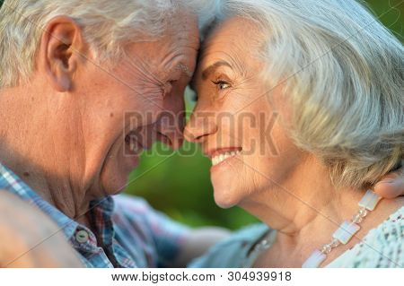 Beautiful Senior Couple Hugging In The Summer Park
