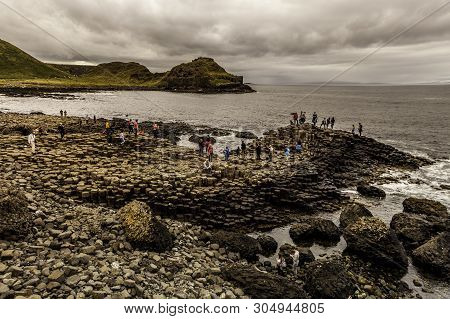 County Antrim, Northern Ireland  - August 2: Visitors Exploring The Giants Causeway. August 2, 2018