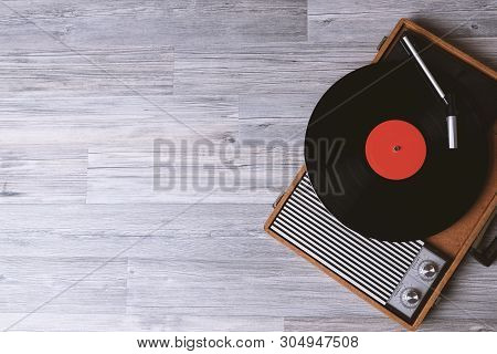 Turntable Vinyl Record Player On The Background Of Their Gray Wooden Boards. Needle On A Vinyl Recor