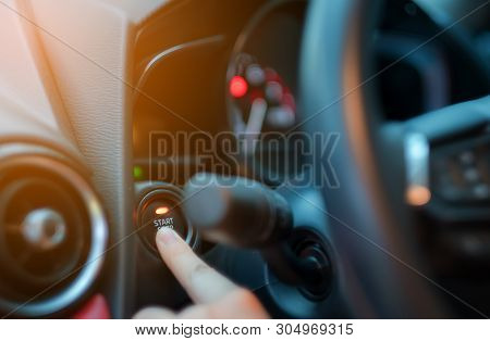 Closeup Hand Pushing On Car Start Engine, Woman Driver Pushing A Start Ignition Button Switch In The