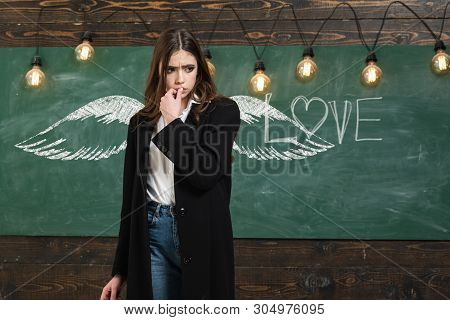 School Wings And Dream. School Lessons. Young Attractive Teacher Pointing At Chalkboard. Back To Sch