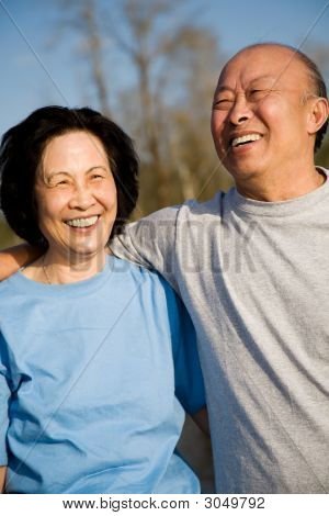 A shot of a senior asian couple having fun outdoor poster