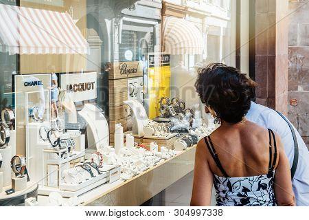 Strasbourg, France- Jul 22, 2017: Young Couple Admiring The Showcase Window Vitrine Of Luxury Fashio