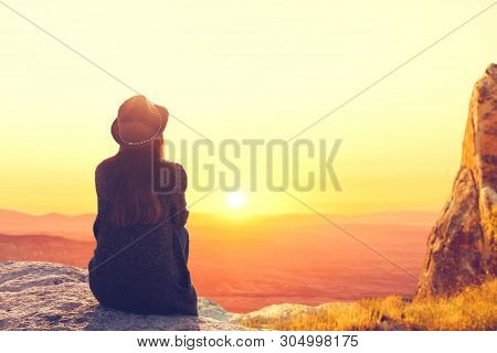 A Woman Sits On Top Of A Mountain And Admires The Beautiful Natural Landscape. Digital Detox And Sou
