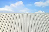 corrugated aluminum roof with a blue sky poster