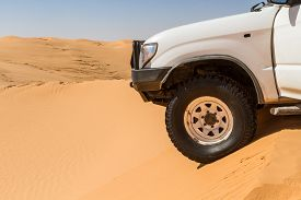 Close Up Image Of A Off Road Car In The Sahara Desert. Tunisia, North Africa