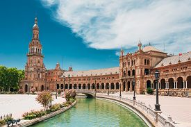 Seville, Spain. Canal Promenade Around Famous Landmark - The Plaza De Espana In Seville, Andalusia,