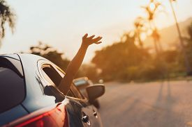 Hatchback Car Travel Driving Road Trip Of Woman Summer Vacation In Blue Car At Sunset,girls Happy Tr