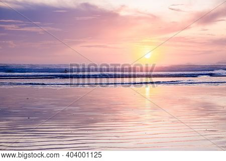 Sunset On The Beach Of Tofino Vancouver Island, Pink Purple Soft Colors In The Sky During Sunset Van