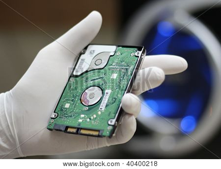 Holding A Computer Hard Drive Disc