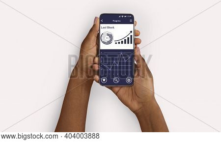Progress Tracker App. Black Female Hands Using Phone With Fitness And Workout Tracker On Screen Over