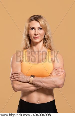 Sports Lifestyle, Athlete, Fitness Blogger And Remote Training. Calm Adult Beautiful Woman In Sports