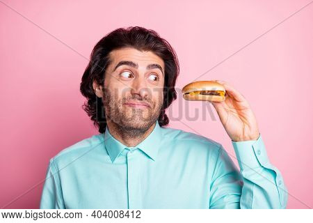 Photo Portrait Of Guy Holding Cheeseburger In One Hand Looking At It In Temptation Isolated On Paste