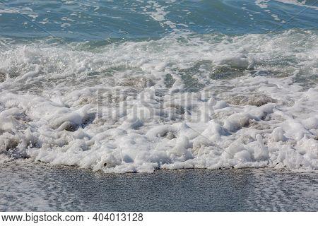 Blue Sea Water Waves With White Foam And Bubbles. Winter See. Riva Trigoso On Ligurian Coast
