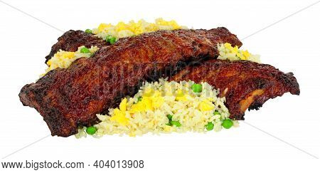 Chinese Peking Style Pork Ribs Coated With Sticky Plum Sauce Glaze With Egg Fried Rice Isolated On A