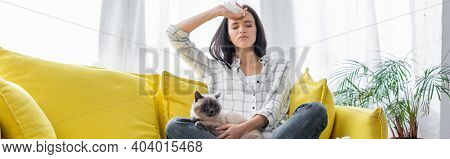 Allergic Woman Suffering From Headache While Sitting On Yellow Couch With Cat, Banner