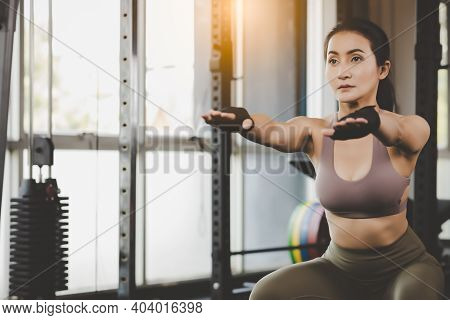 Young Asian Woman Squat Exercise At Gym Fitness Lady Booty Bottom Athlete With Determined Sport Girl