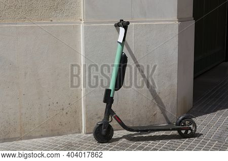 Electric Scooters Or E-scooters Parked In The Pedestrian Zone - E-mobility Or Micro-mobility Trend