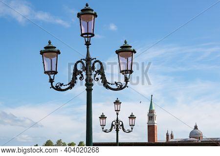 3-headed Lanterns Lining Up Towards Campanile Tower Of Venice, Italy