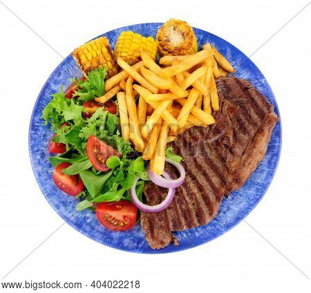 Grilled Sirloin Steak And French Fries Meal With Fresh Salad And Sweetcorn Cobs Isolated On A White