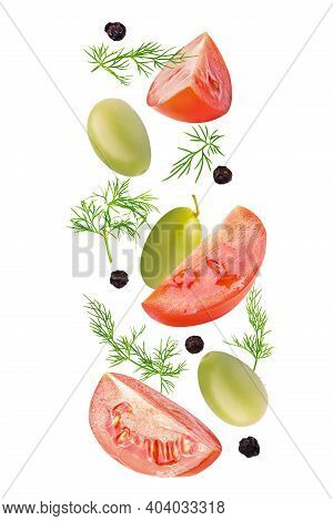 Set Of Flying Fresh Ingredients For The Salad On White Background