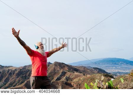 Senior Athlete Man Greeting Sunrise And World, Mindful Living And Healthy Wellbeing Concept