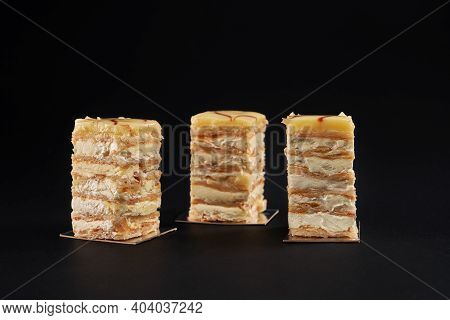 Three Square Pieces Of White And Yellow Creamy Cake, Sweet Delicious Dessert. Tasty Light Mousse Wit