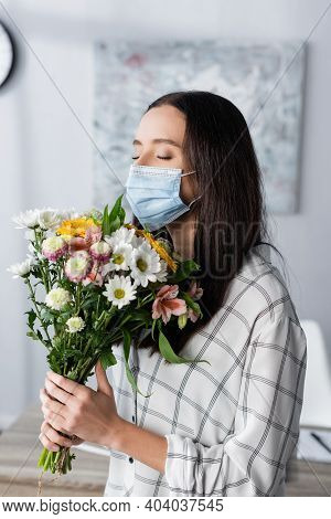 Young Allergic Woman In Medical Mask Holding Bouquet With Closed Eyes