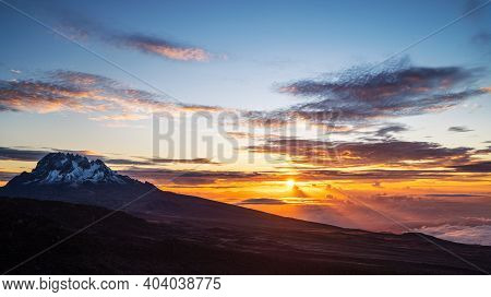 The Blue Morning Sky Over The Kilimanjaro 5895m High Mount - The Highest Point Of Africa And The Hig