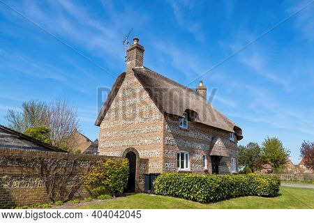 Traditional thatched cottage in Dorset, UK. Image taken from a public position.