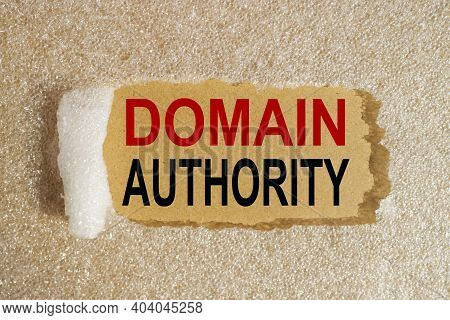 Domain Authority, Text On Blackboard On Torn Paralon