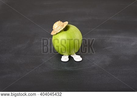 Green Apple In Straw Hat, Conceptual Photo.