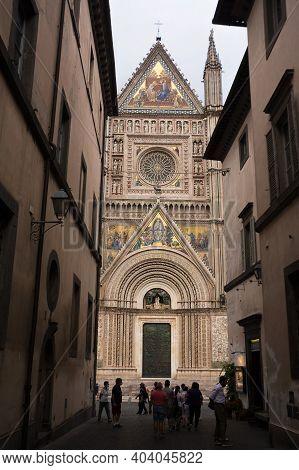 Orvieto, Italy - 20 September 2020: Facade Of The Orvieto Basilica Decorated With Mosaics And Touris