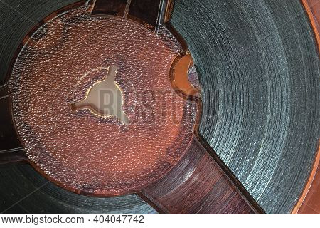 Close-up Of Old Movie Coil With Motion Picture. Vintage Background, Retro Style. Photo, Movie, Cinem