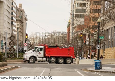 Red Dump Truck Blocking Roads In And Out Of Washington Dc
