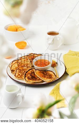 Homemade Delicious Pancakes With Fresh Apricot Fruit And Jam On A Light Slate, Stone Or Concrete Bac