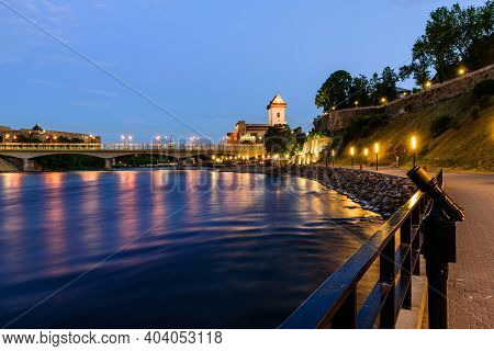 Beautiful Night View Of Narva Castle With Tall Herman's Tower And The Ancient Russian Fortress In Iv