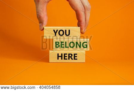 You Belong Here Symbol. Wooden Blocks With Words 'you Belong Here' On Beautiful Orange Background. M