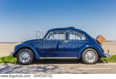 Noordoostpolder, Netherlands - April 20, 2019: Classic Blue Volkswagen Beetle With A Picknick Basket