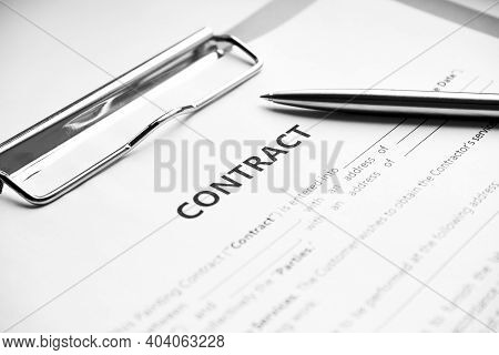 Close-up Of A Silver Pen On Docunent Contract. Legal Contract Signing, Buy Sell Real Estate Contract