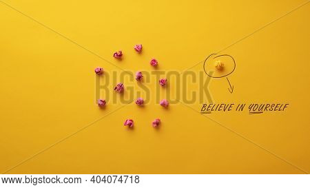 Believe In Yourself Message Spelled On Yellow Background In Conceptual Image Of Individuality And Co