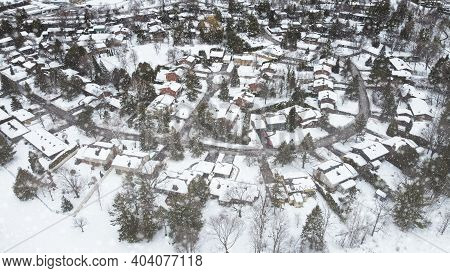 Aerial Top View Of A Winding Foot Path In Winter , Surrounded By Snow. Kanata Neighborhood Can Be Se