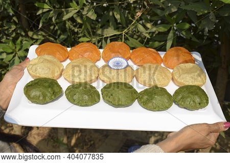 Female Holding Homemade Colourful Puris Made From Spinach, Carrot, On Occasion Of Indian Republic Da